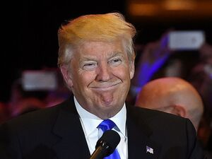 Donald Trump smiles as he arrives to speak at Trump Tower after his victory Tuesday night in the Indiana GOP primary.