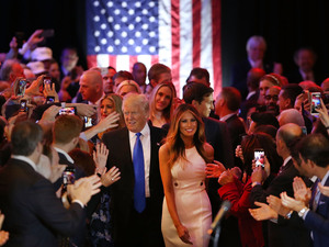 Donald Trump and his wife Melania arrive to speak to supporters at Trump Tower in New York following his victory in Indiana Tuesday. Improbably, Trump is now assured of being the GOP nominee.
