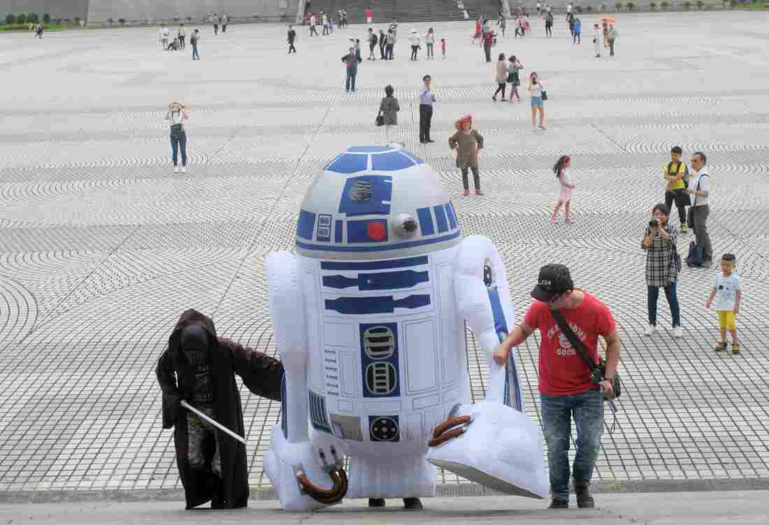 A Star Wars fan, dressed as R2D2, arrives during the annual Star Wars Day in Taipei, Taiwan, on May 4.