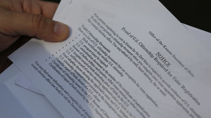 A Kansas resident shows part of a letter from election officials listing valid citizenship documents needed to register to vote in Kansas.