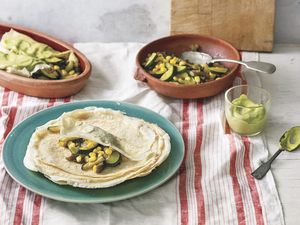 Crepes are a cousin of the enchilada, says Mexican chef Pati Jinich. A vestige of French intervention in Mexico, crepes are now considered classics of Mexican gastronomy. Above, Jinich's crepe enchiladas with corn, poblano chiles and squash in an avocado-tomatillo sauce.