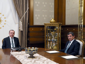 Turkey's President Recep Tayyip Erdogan, left, and Prime Minister Ahmet Davutoglu pose for a photograph at the start of a meeting in Ankara, Turkey, Wednesday. Davutoglu announced Thursday he would resign.