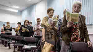 "Jehovah's Witnesses sing songs during a meeting in Rostov-on-Don, Russia, in November 2015. The country's top prosecutor is threatening a nationwide ban for alleged ""extremism."""