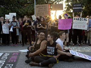 Demonstrators against House Bill 2 protest outside the Governor's Mansion in downtown Raleigh, N.C., on March 24. Among other restrictions, the law says transgender people have to use the bathroom that corresponds with their biological sex rather than their gender identity.