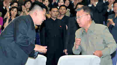 The late North Korean leader Kim Jong Il, right, exchanges words with his son and successor, Kim Jong Un, in July 2011.