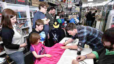 Legendary Batman Writer Scott Snyder signs autographs for DC Comics' Free Comic Book Day Special Issue at Fourth World Comics in 2015 in Smithtown, N.Y.