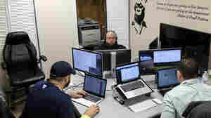 Software coders (from left) William Stevens, Michael Harrison and Brack Quillen work at the Bit Source office in Pikeville, Ky., in February. The year-old firm has trained laid-off coal workers to become software coders.