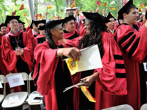 Graduates celebrate during commencement ceremonies at Harvard University.