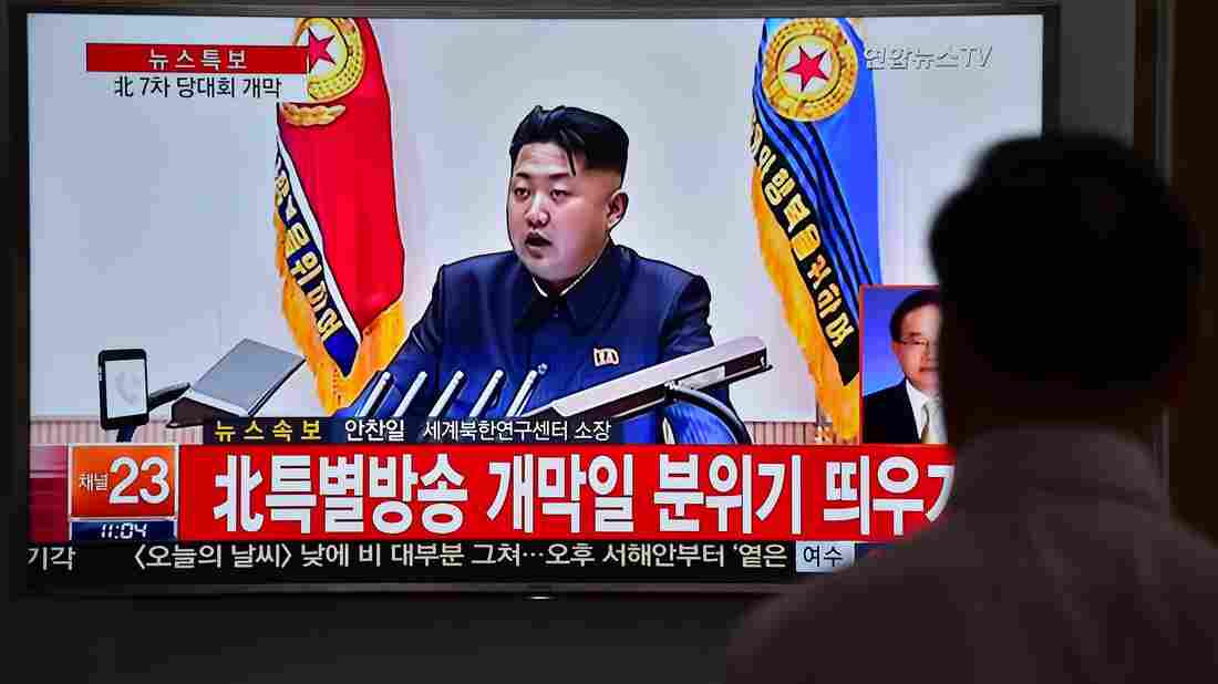 """A man in South Korea watches a news broadcast Friday showing file footage of North Korean leader Kim Jong-Un. Speaking at a major gathering in North Korea, Kim declared """"great success"""" in the country's recent nuclear test and a rocket launch."""