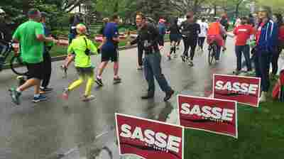 Sen. Ben Sasse hands out water at the Lincoln Marathon in Nebraska. The Republican has vowed not to vote for Trump and is calling for a third candidate to emerge.