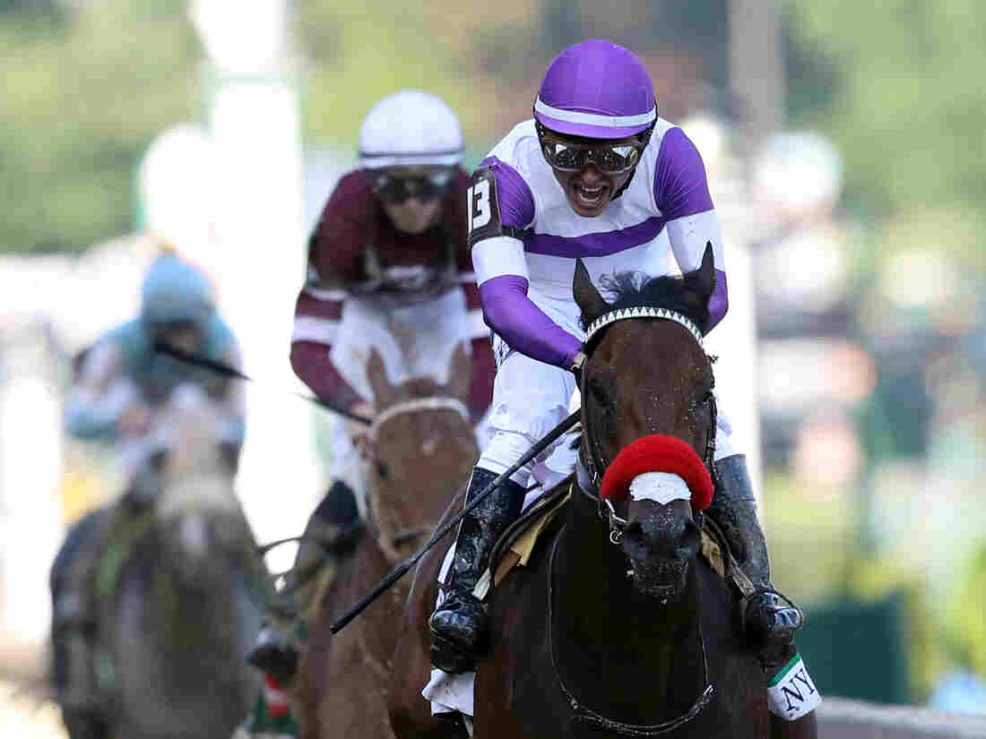 Nyquist, ridden by Mario Gutierrez, crosses the finish line during the 142nd running of the Kentucky Derby at Churchill Downs on May 7.