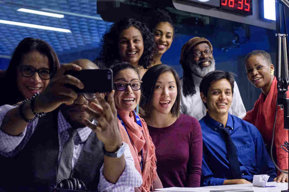 From left to right, standing: Reporter Karen Grigsy Bates, editor Tasneem Raja, news assistant Leah Donnella, producer Walter Ray Watson, editor Alicia Montgomery. Seated: Reporters and hosts Gene Demby and Shereen Marisol Meraji, reporters Kat Chow and Adrian Florido