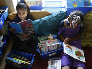Kindergarten students read before class starts at Walker-Jones Education Campus in Washington, D.C.