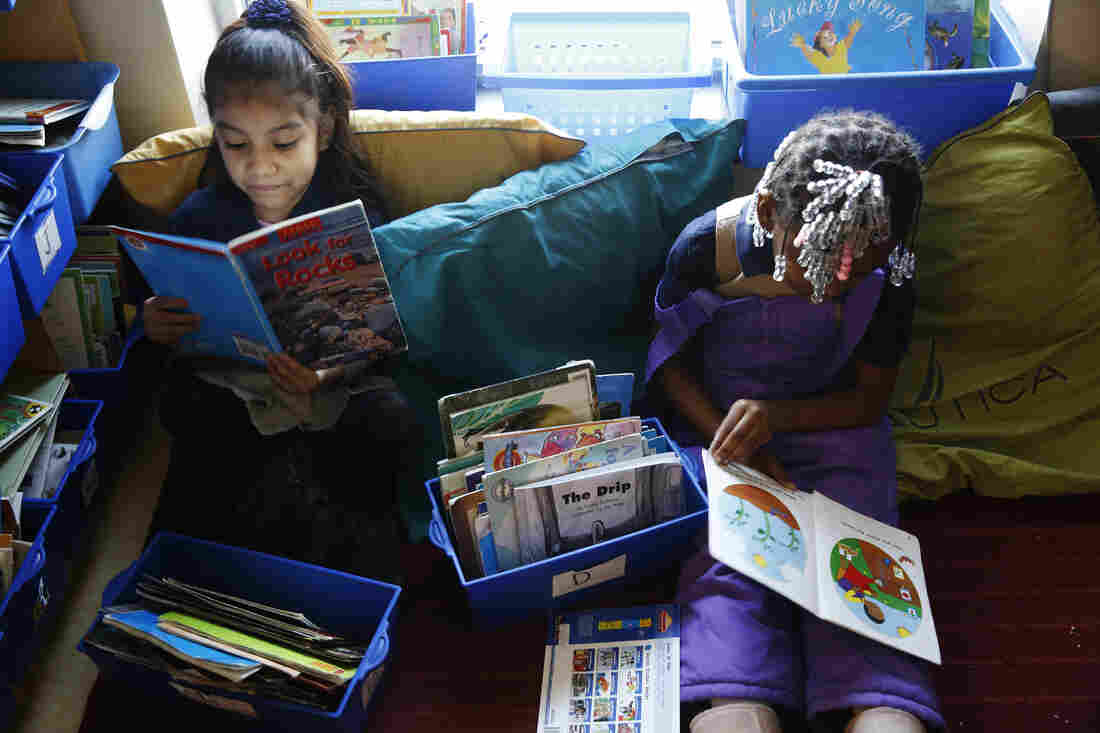 Kindergarten students read before class starts at Walker-Jones Education Campus in Washington, D.C.