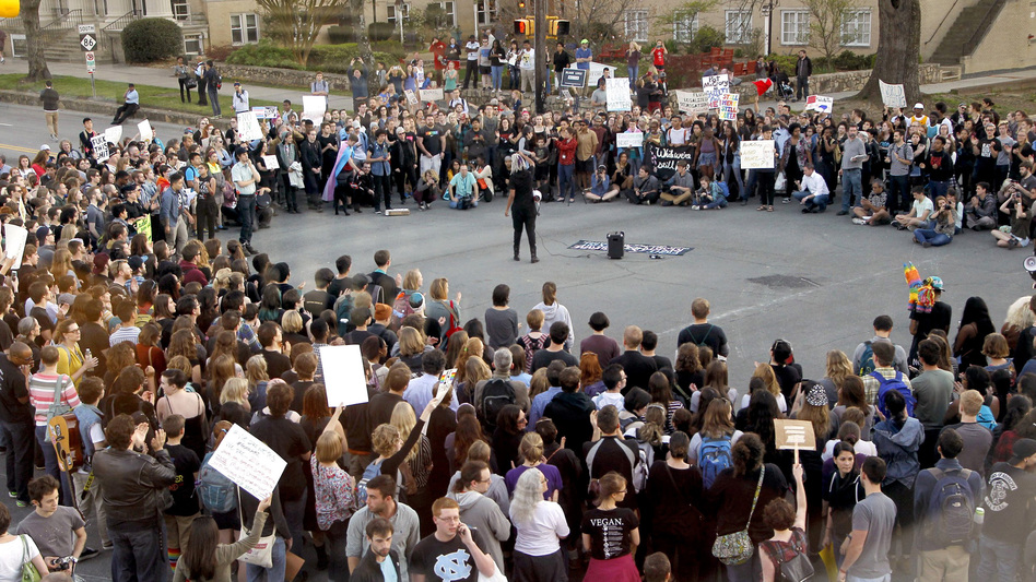 Hundreds attend a rally in Chapel Hill, N.C., on March 29 to protest the passage of House Bill 2. The state of North Carolina and the U.S. Justice Department are suing each other over the law's restriction on protections for lesbian, gay, bisexual and transgender people. (Chris Seward/Raleigh News & Observer/TNS via Getty Images)