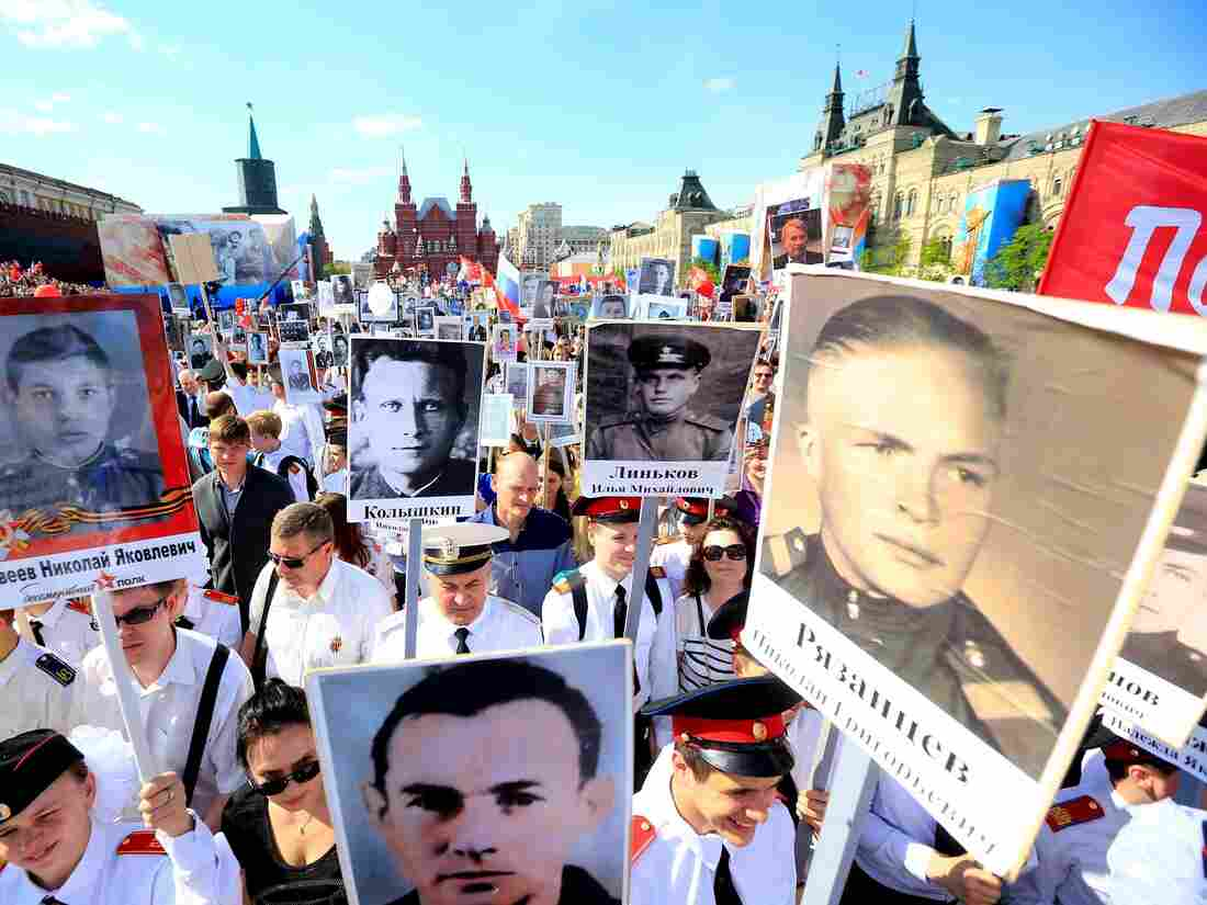 People in Moscow hold portraits of relatives who fought in World War II during the Immortal Regiment march on the day of the 71st anniversary of the victory over Nazi Germany in World War II.