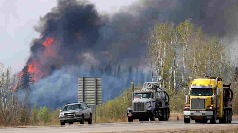 A wildfire burns near Highway 63 south of Fort McMurray, in the Canadian province of Alberta, on Sunday.