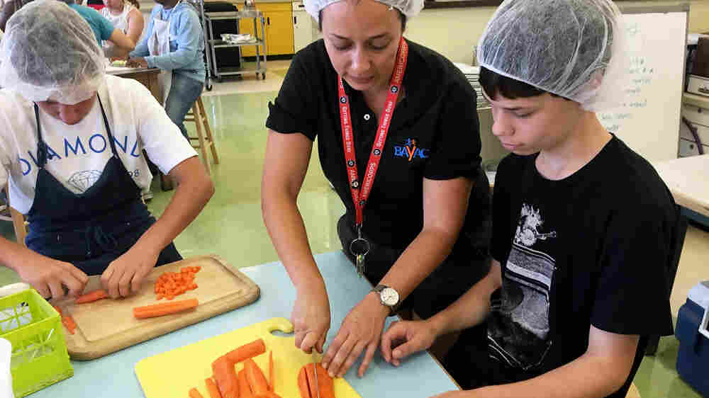 Willard Middle School students chop carrots for a meal they will sell through Josephine.