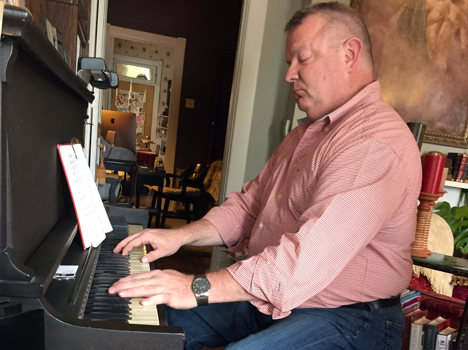 Music has been part of Nick Wilson's life since he was a child, when he taught himself to play the piano. He plays daily in the living room of his shotgun house in Louisville. (NPR)