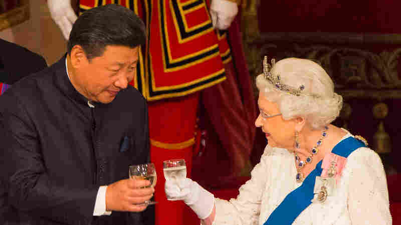 "Chinese President Xi Jinping (left) toasts with Britain's Queen Elizabeth II during a state banquet at Buckingham Palace in London on the first day of the state visit in October 2015. Elizabeth said on camera that Chinese officials had been ""very rude"" during the official visit."