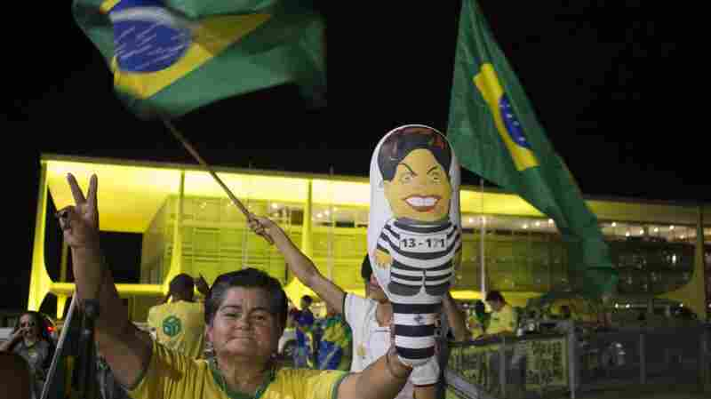 People supporting impeachment of Brazilian President Dilma Rousseff demonstrate in front of Planalto Palace in Brasilia on Tuesday. Brazil's Senate is voting Wednesday on whether to impeach Rousseff, who is accused of using accounting tricks and unauthorized state loans to boost public spending during her 2014 re-election campaign.