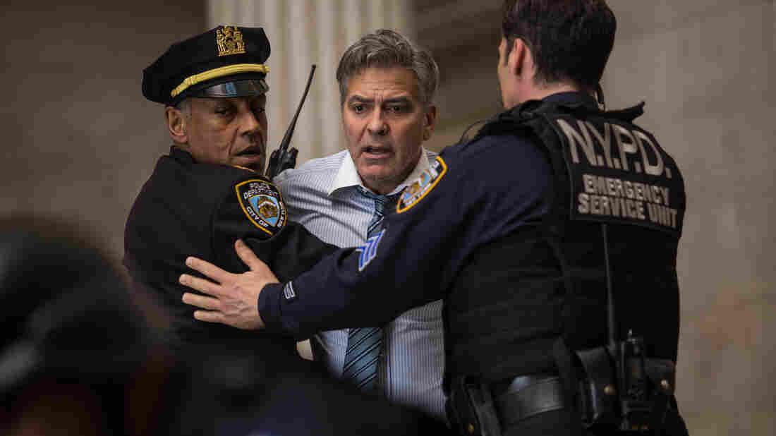 Giancarlo Esposito and George Clooney in Jodie Foster's thriller Money Monster, which never gets quite as crazy or convincing as, say, The Big Short.