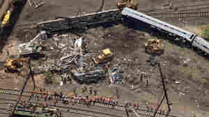 Investigators and first responders work near the wreckage of Amtrak Northeast Regional Train 188, which derailed May 13, 2015, in north Philadelphia. Eight people were killed and hundreds injured in the crash.