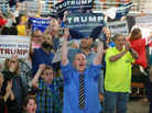 Supporters of Republican presidential candidate Donald Trump shout at the media prior to a rally at the Charleston Civic Center on May 5 in Charleston, W.Va.