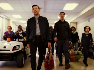 """The Avett Brothers are joined by other passengers at an airport for a joyful singalong in a scene from a new video for the song """"Ain't No Man."""""""
