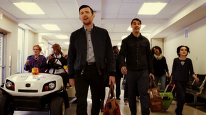 "The Avett Brothers are joined by other passengers at an airport for a joyful singalong in a scene from a new video for the song ""Ain't No Man."""