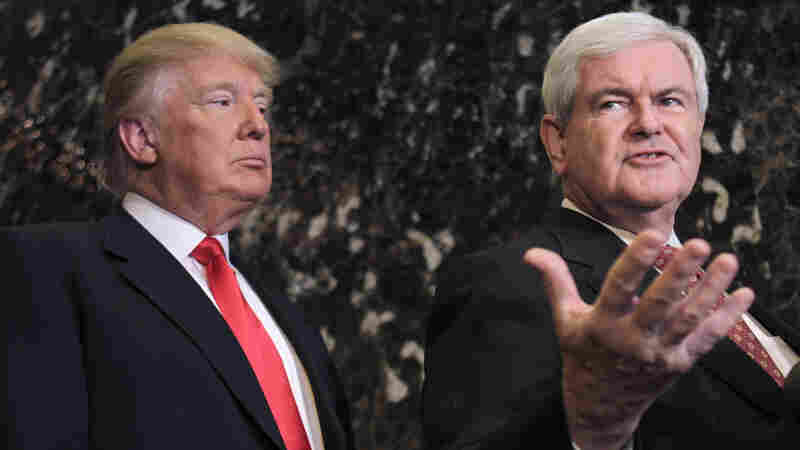 Donald Trump listens as former House Speaker Newt Gingrich talks to the media after a meeting in New York in 2011 when Gingrich was running for president.