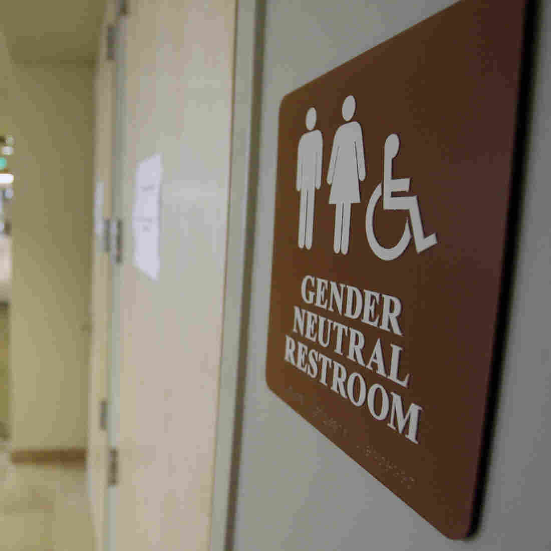 A sign marks the entrance to a gender-neutral restroom at the University of Vermont in Burlington, Vt.