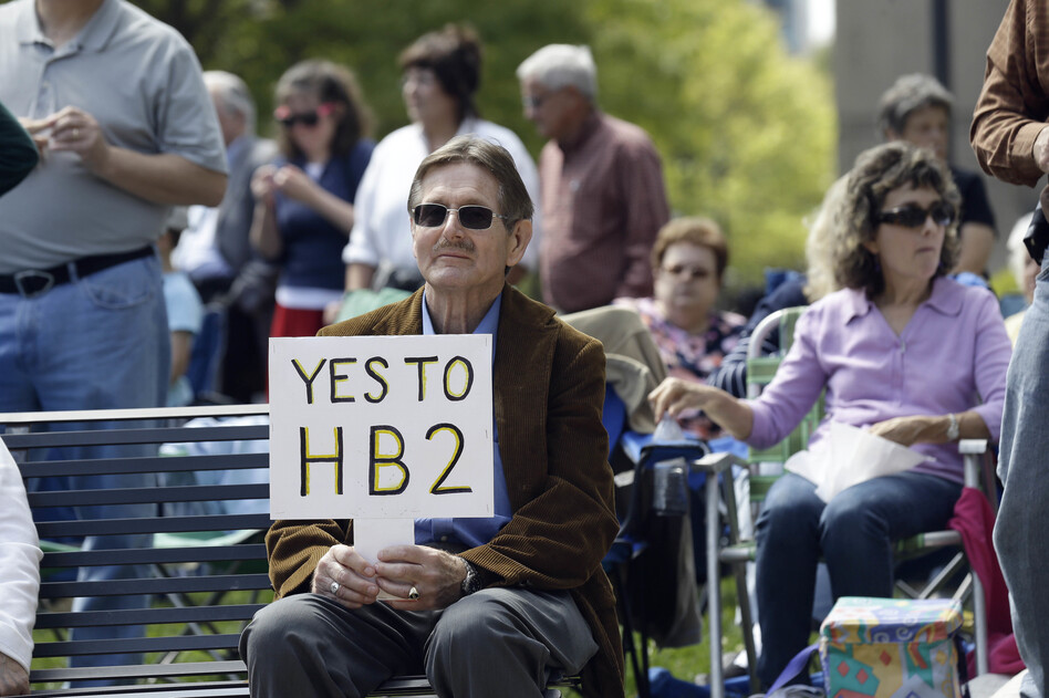 Supporters of House Bill 2 gather for a rally at the North Carolina State Capitol in Raleigh, N.C., on April 11. A recent poll found that nearly 49 percent of North Carolinians support at least some part of the controversial law. (Gerry Broome/AP)
