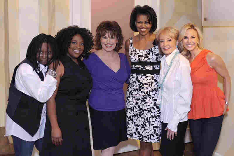 Michelle poses with the co-hosts of The View on June 18, 2008. Her dress from White House/Black Market sold out completely after her appearance on the show.
