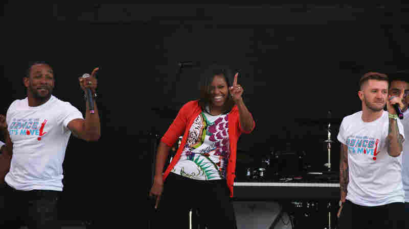 First Lady Michelle Obama wears her signature cardigan while dancing with performers from the television show So You Can Dance during the annual White House Easter Egg Roll on April 6, 2015.
