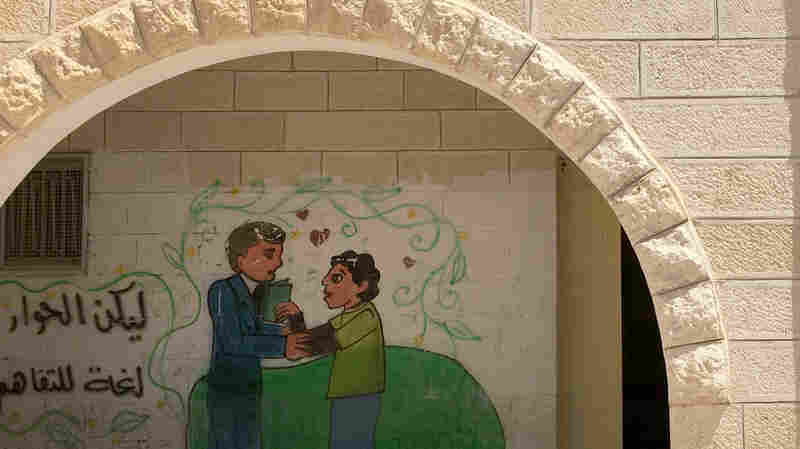 A mural on the wall of the boys' high school in Sair, a Palestinian town in the West Bank. More than a dozen young men from Sair were killed by Israeli forces since last fall, including during attacks on Israelis.