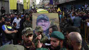 Hezbollah supporters carry the coffin of their slain top commander Mustafa Badreddine during his funeral procession in a southern suburb of Beirut, Lebanon, on Friday.