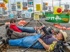 A rally, march and mass civil disobedience to stop oil trains in the Port of Albany was held on Saturday by more than 1,500 people from Albany, N.Y., and from as far as Maine, Quebec and central Pennsylvania.