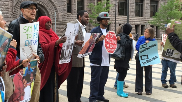 Protesters gathered outside the federal courthouse in Minneapolis where three young Somali-Americans are on trial for allegedly planning to go to Syria to join the Islamic State. The demonstrators say the FBI and local law enforcement is targeting and entrapping Somali-Americans in terrorism cases. Six men have already pleaded guilty. (Dina Temple-Raston / NPR)