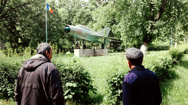 A MiG-21 fighter — a leftover monument from the Soviet era — is the centerpiece of the Aviators Neighborhood in Deveselu, Romania. Now the base has become a U.S. Navy facility that is part of NATO's anti-missile shield for Europe. (Gabriel Amza for NPR)