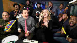 The Tonight Show's Jimmy Fallon and house band The Roots sing with Adele during the show's Music Room segment.