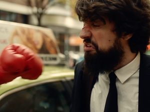 """Anthony D'Amato takes one of many punches to the face in a scene from a new video for the song """"Golden Gloves."""""""