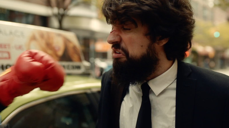 "Anthony D'Amato takes one of many punches to the face in a scene from a new video for the song ""Golden Gloves."""