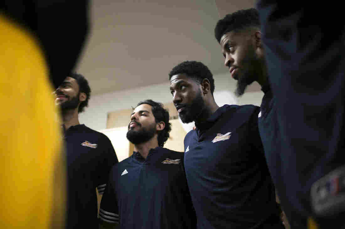 Holland (second from right) and his teammates gather to pray before a game against Iowa Energy in the locker room of the Canton Memorial Civic Center on Feb. 16.