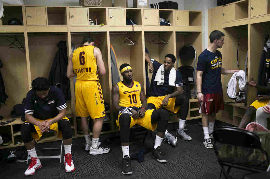 Holland (center, wearing sweat band) and the rest of the Charge take a break during halftime in the locker room of the Canton Memorial Civic Center on Feb. 16.