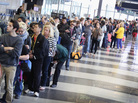 Passengers wait in line to be screened at a Transportation Security Administration checkpoint at Chicago's O'Hare International Airport on Monday.