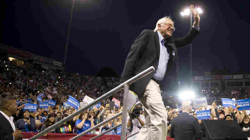 Democratic presidential candidate Bernie Sanders waves as he walks onto the stage during a rally Tuesday in Carson, Calif.
