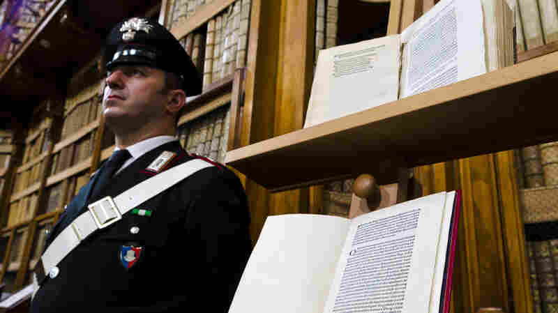 Two versions of a letter from Christopher Columbus about his discovery of the New World are displayed in Rome. The book on the bottom, produced centuries ago, has just been returned after having been stolen and replaced with a forgery (top).