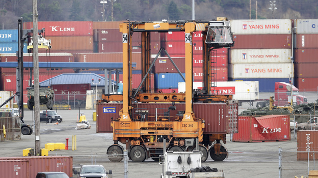 Ships transporting containers like these at the Port of Tacoma, Washington, last year carry the goods at issue in the TPP deal. A new report says the trade pact would boost the U.S. economy, but only by a modest amount. (AP)