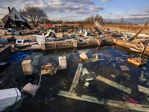 A still-running water pipe floods the foundation of a home destroyed by the storm surge of Superstorm Sandy in Staten Island, New York in a photo taken on November 28, 2012.